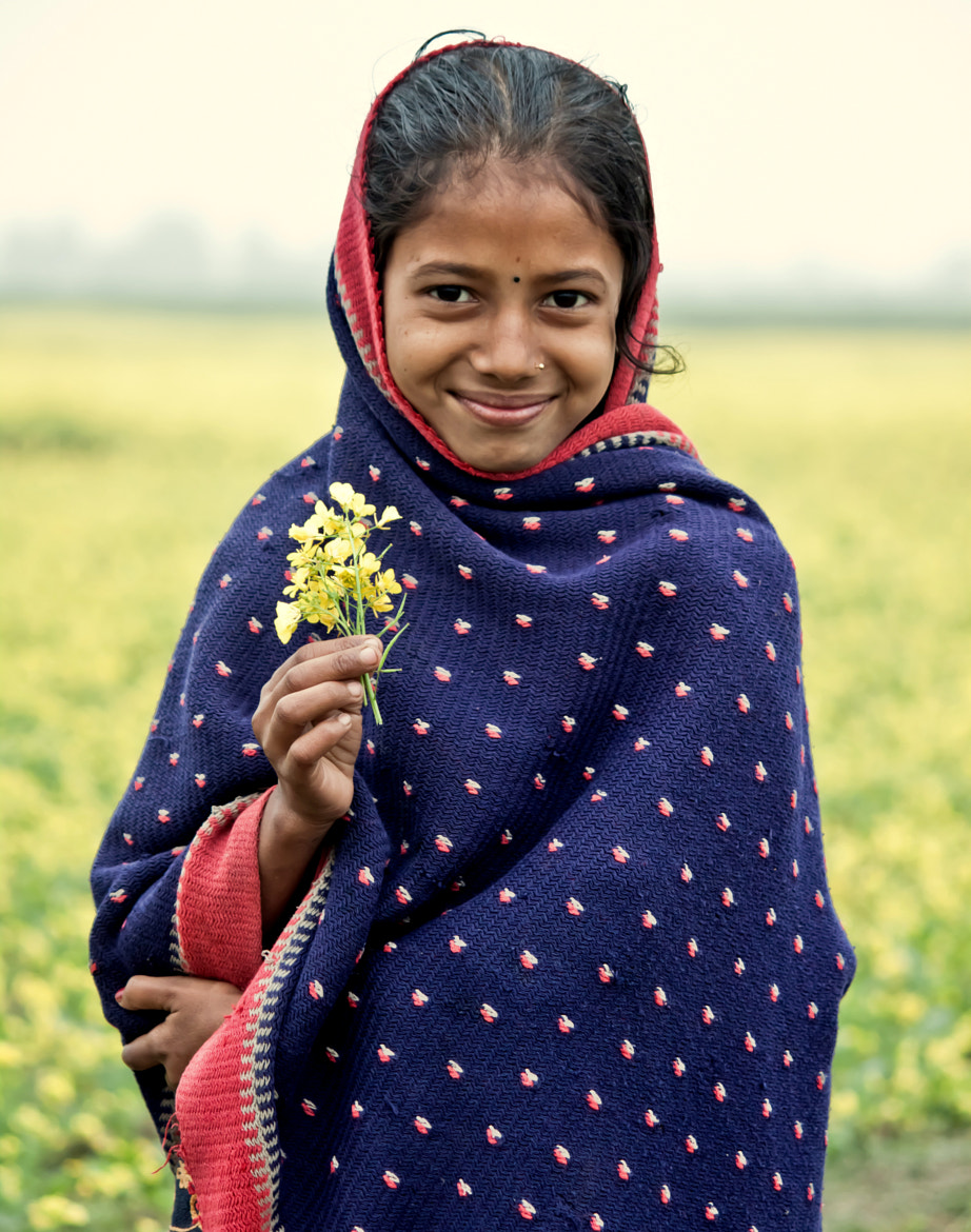 Photograph A flower and a smile to light up your day.. by Samrat  Mukhopadhyay on 500px