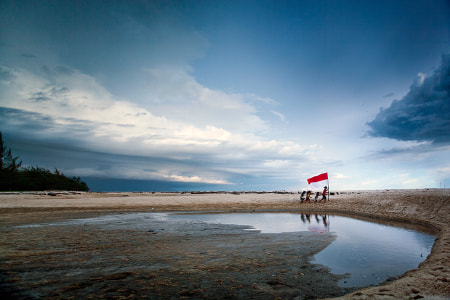 playing on the beach by dewan irawan
