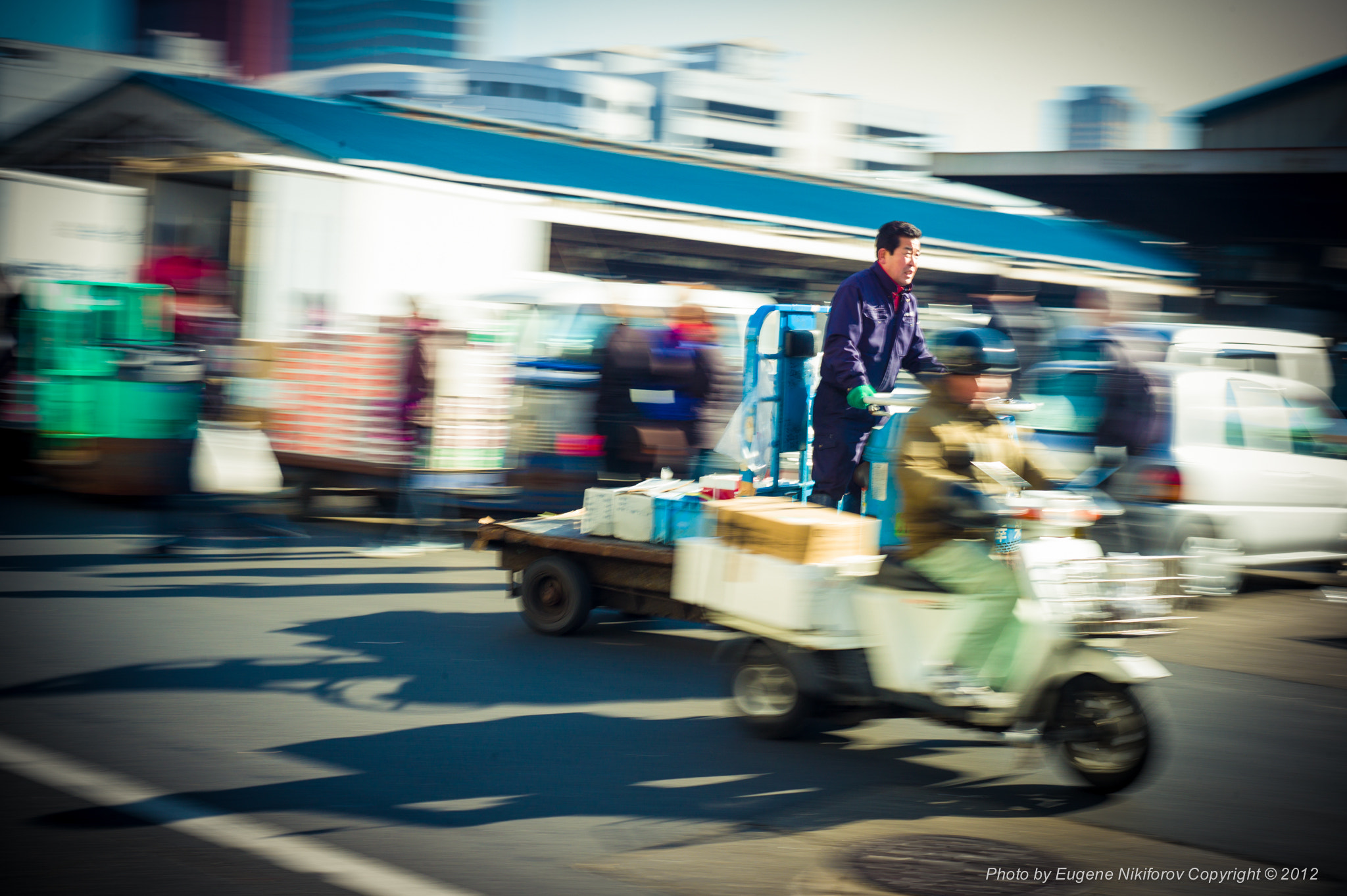 Photograph Who is faster? Tsukiji Fish Market, Tokyo by Eugene Nikiforov on 500px