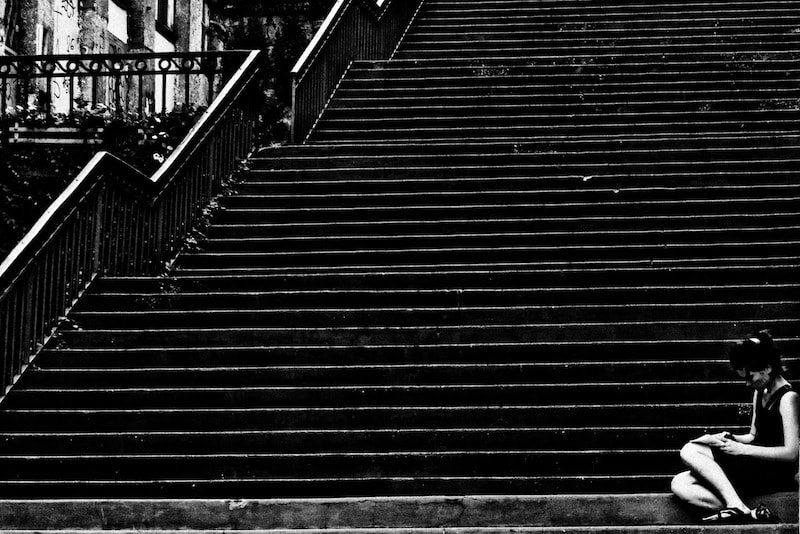 Photograph girl reading down stairs by Guillaume GUERITAUD on 500px