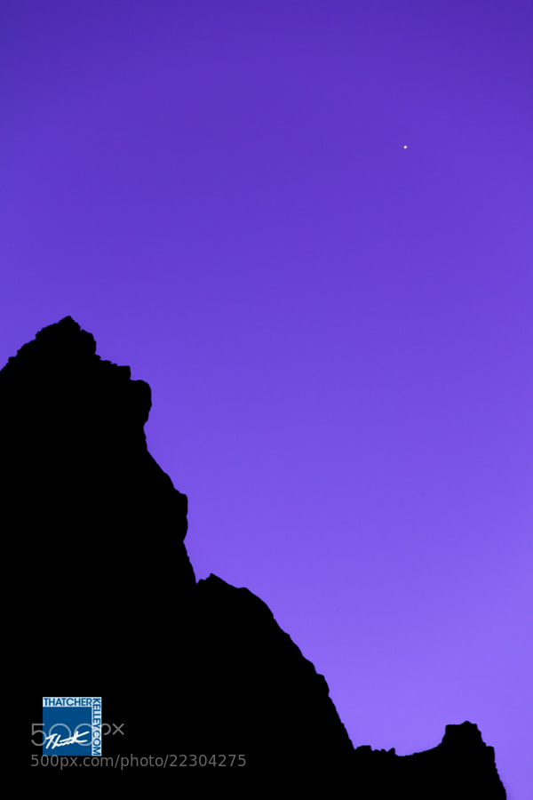 The first star of the night becomes visible in the fading glow of dusk.