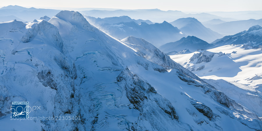 A broken-up Kennedy Glacier reaches the windy summit of Glacier Peak.
