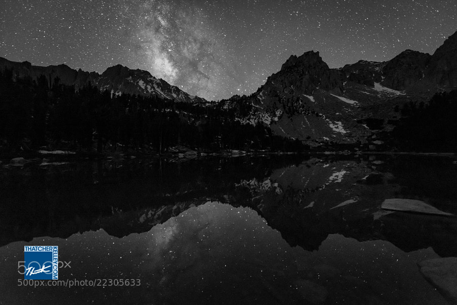 The Milky Way reflects brilliantly in the waters of Flower Lake in the Eastern Sierra.