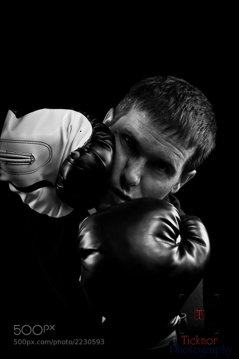 Photograph Shadow Boxer getting Punched by Ticknor Photo on 500px