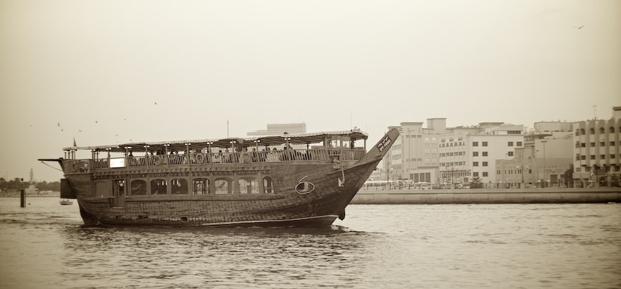 Photograph Old Dowe running tourists along Dubai Creek by Sean Cheng on 500px