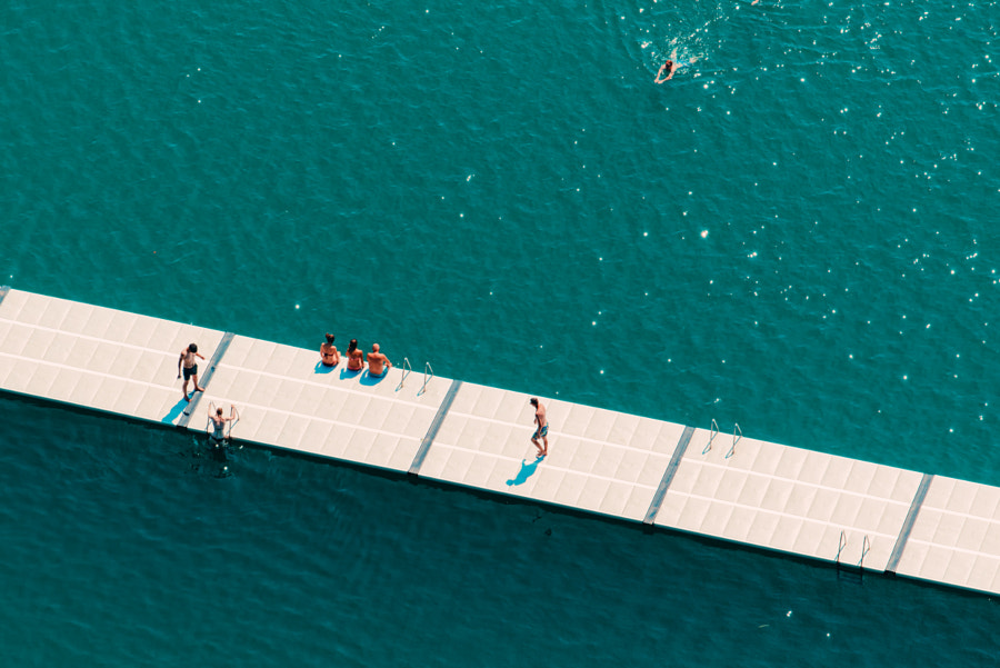Unrecognizable people enjoying summer afternoon on lake by Igor Stevanovic on 500px.com
