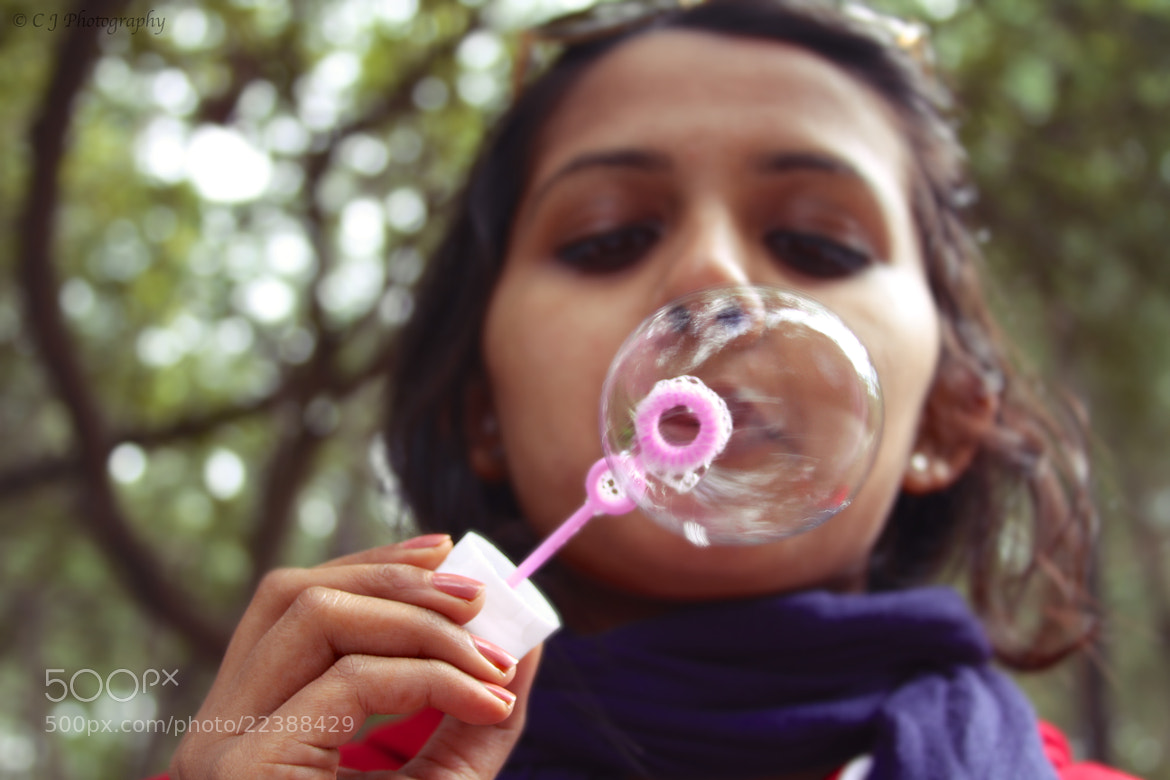 Photograph Blowing bubbles. by Chaitanya Janga Pratap on 500px