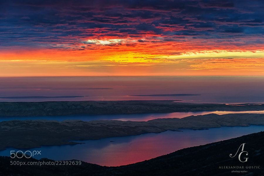 Dusk over the misty Adriatic, observed from Velebit mountain. Behind the Velebit channel is Pag island, barren by Bura wind