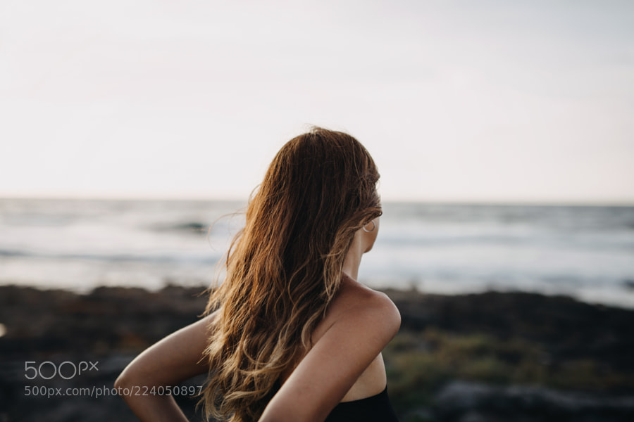 Young woman looking at the ocean