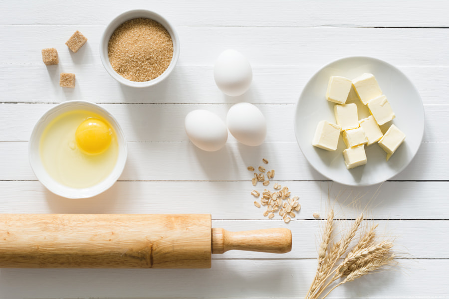 Baking cake or cookies ingredients on white wooden table top view by Vladislav Nosick on 500px.com