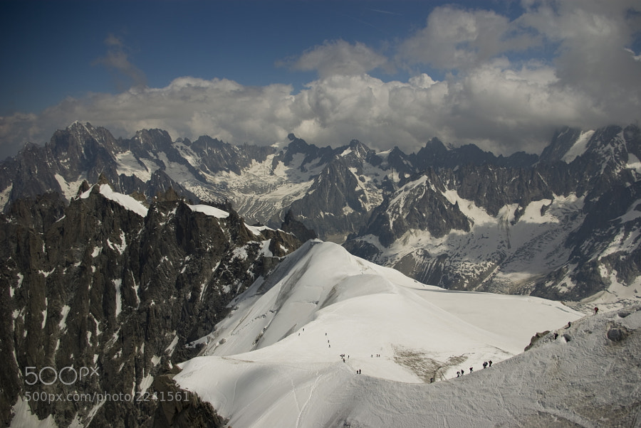 The Aiguille du Midi (3,842 m) is a mountain in the Mont Blanc Massif in the French Alps. Aiguille du Midi offers a 360° viewpoint over the French, Swiss and Italian Alps from its vast terraces. The access by cablecar (two 10-minute long journeys) is spectacular!