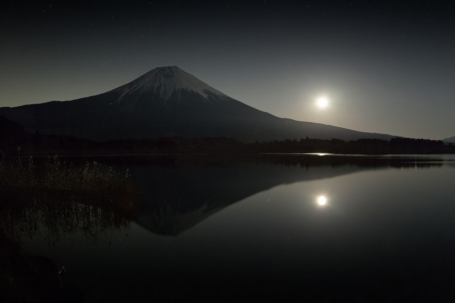 This place is lake Tanukiko west side of Mt.Fuji. Moon was half one. I could take an inverted image of Mt.Fuji reflected in the lake of dark. (taken at 0:06 AM)