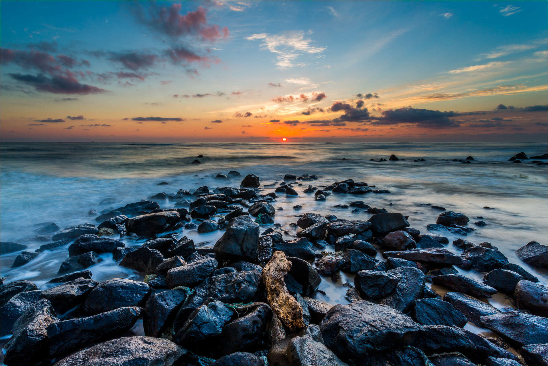 Photograph Red dawn on black rocks by Christopher Martin on 500px