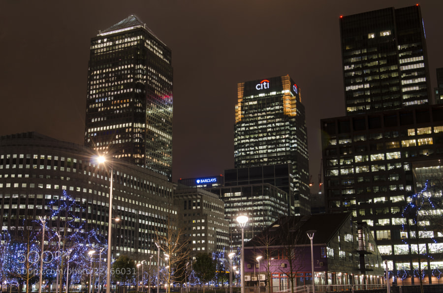 View of Canary Wharf at night, showing Citi Bank and Barclays