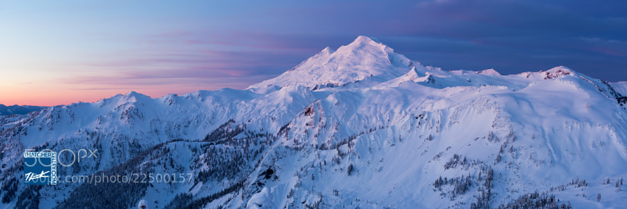 Near Washington State's northern border,  Mount Baker towers over the surrounding mountains.  Mount Baker is one of the snowiest places on earth.