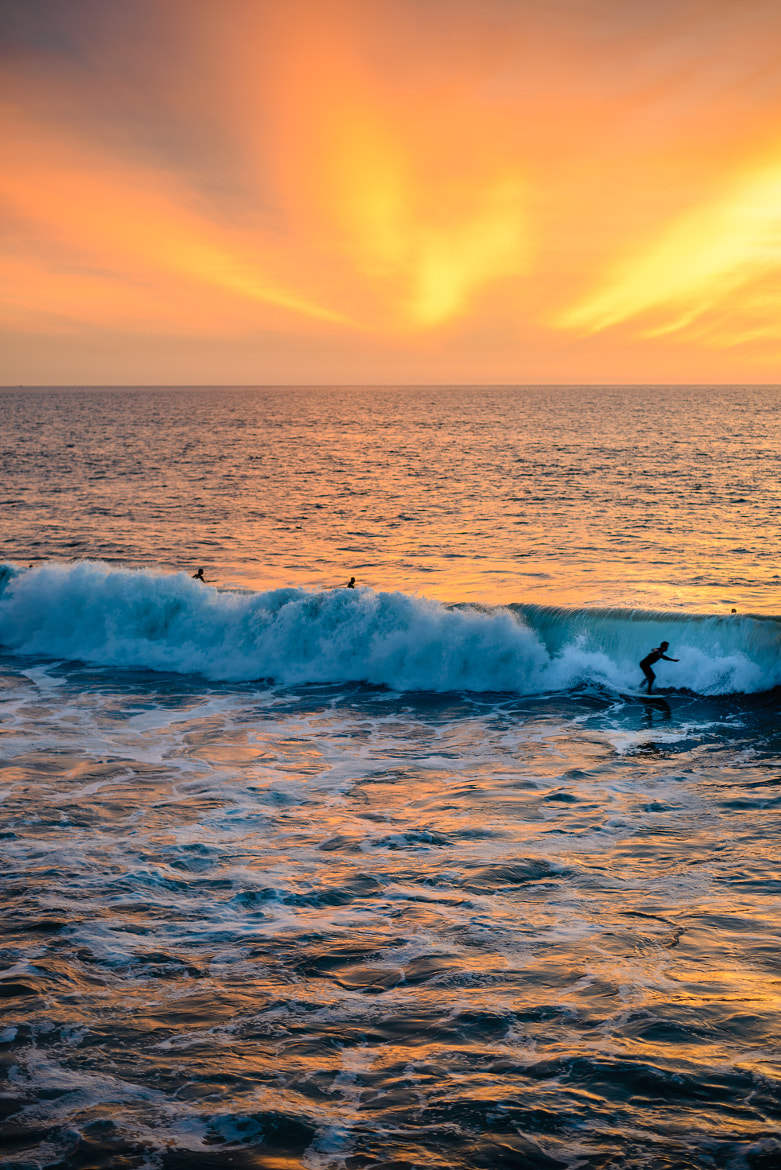 Photograph Sunset Surfers by rkaika on 500px