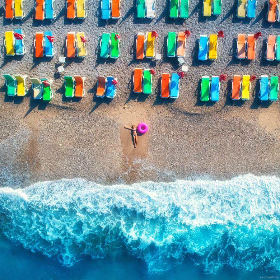 Aerial view of lying woman with swim ring in the sea by Denys Bilytskyi on 500px.com