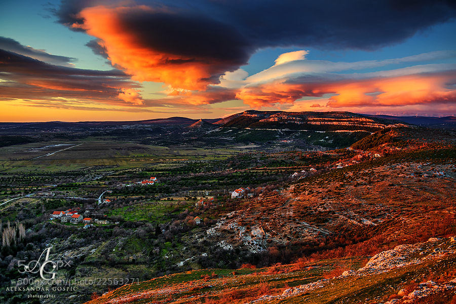 Setting sun colored the lenticular altocumulus clouds which, powered by strong Bura wind from the Velebit mountain, ruled the skies above Northern Dalmatia today