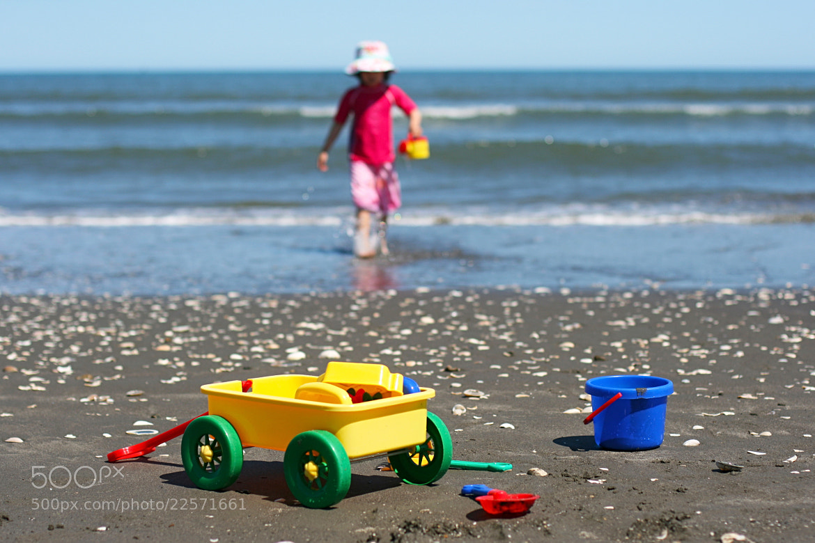Photograph Playing on beach by Wayne Tan on 500px