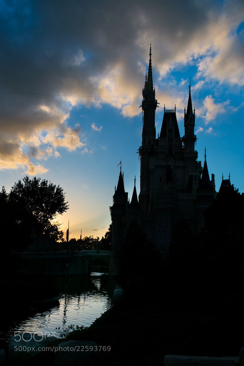 Photograph The Sun Sets on the Magic Kingdom by Kurt Miller on 500px