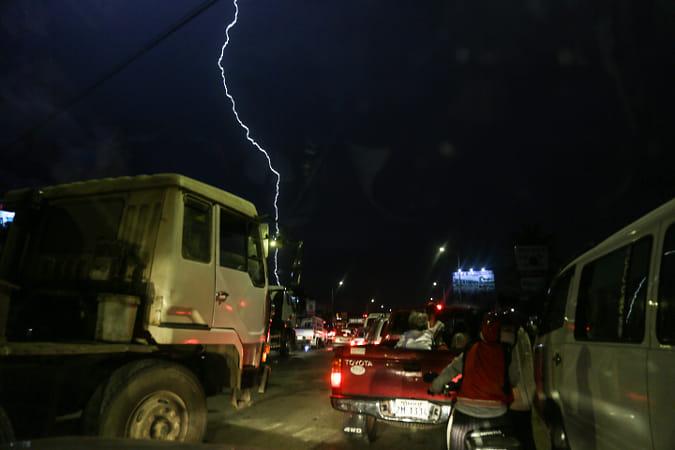 A lightening strikes during the traffic jam.