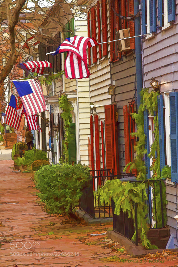 Old Town Alexandria is know for its colonial charm and display of its patriotism.  Brick sidewalks, colorful houses and waving flags make for a wonderful image to capture.