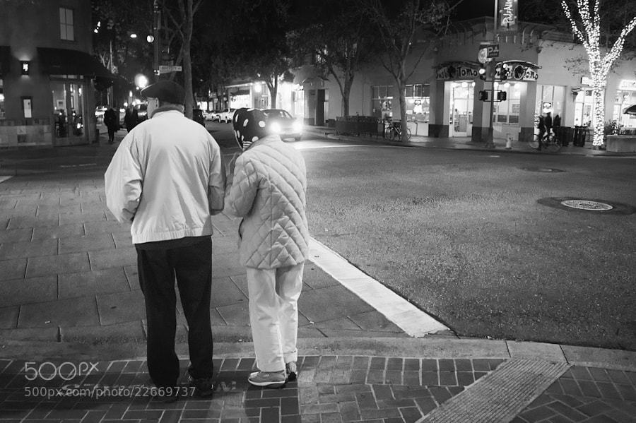 Elderly couple out Christmas shopping in Palo Alto, California.