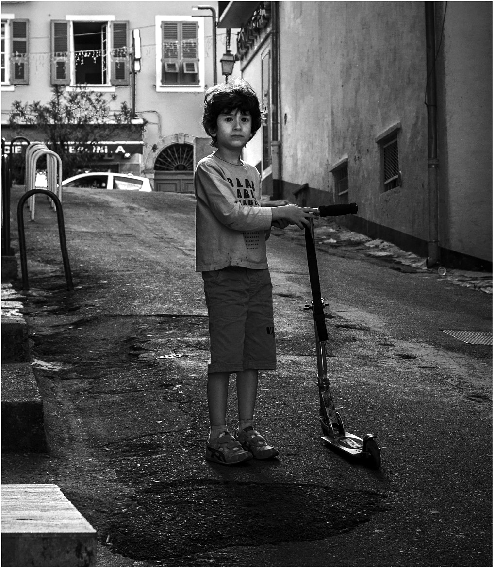 Photograph  A boy with scotter by Milello  on 500px