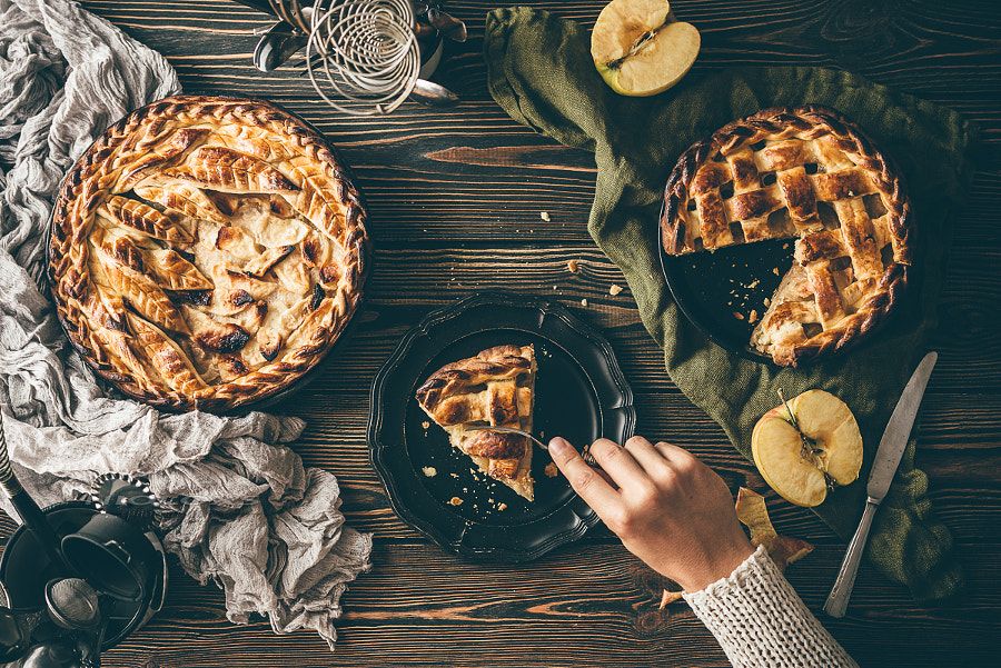 American apple pies on dark wooden table, top view by Kamil Zabłocki on 500px.com