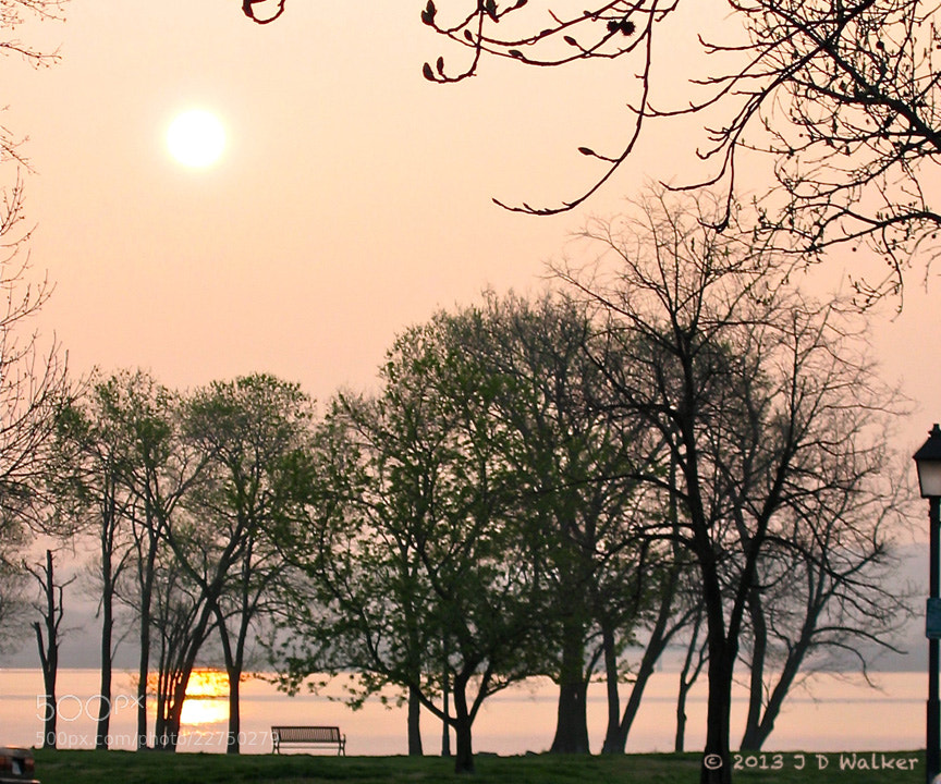 Sunrise over the Potomac River on a peaceful Sunday Morning.  This is Founders Park in Alexandria, Virginia.
