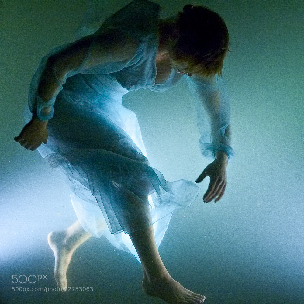 Photograph Walking on a beam of light by Mathias Vejerslev on 500px