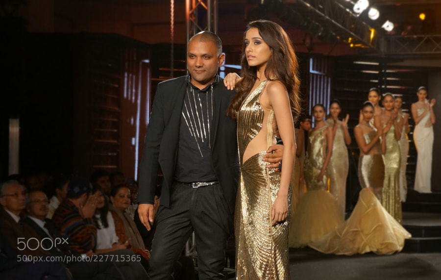 Show stopper Shraddha Kapoor and the Designer Gaurav Gupta hand in hand at the end of the fashion show at Blender's Pride Fashion Tour which was held in Bengaluru city, Karnataka (India). Shraddha Kapoor looked ravishing in this flowy gold gown, Couturier Gaurav Gupta is known for creating gowns and dresses for special days.  Visit LifeThoughtsCamera.com (Lifestyle website ranked #8 in TopIndianBlogs) to view all my posts.  ..