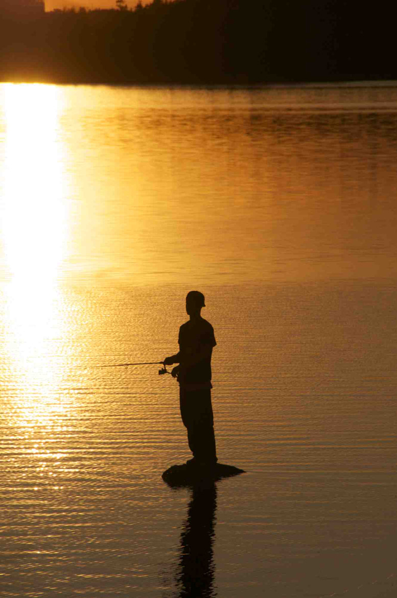 Photograph Young Man Fishing by Don Martin on 500px