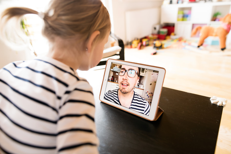 Little girl at home with tablet, video chatting with her father. by Jozef Polc on 500px.com