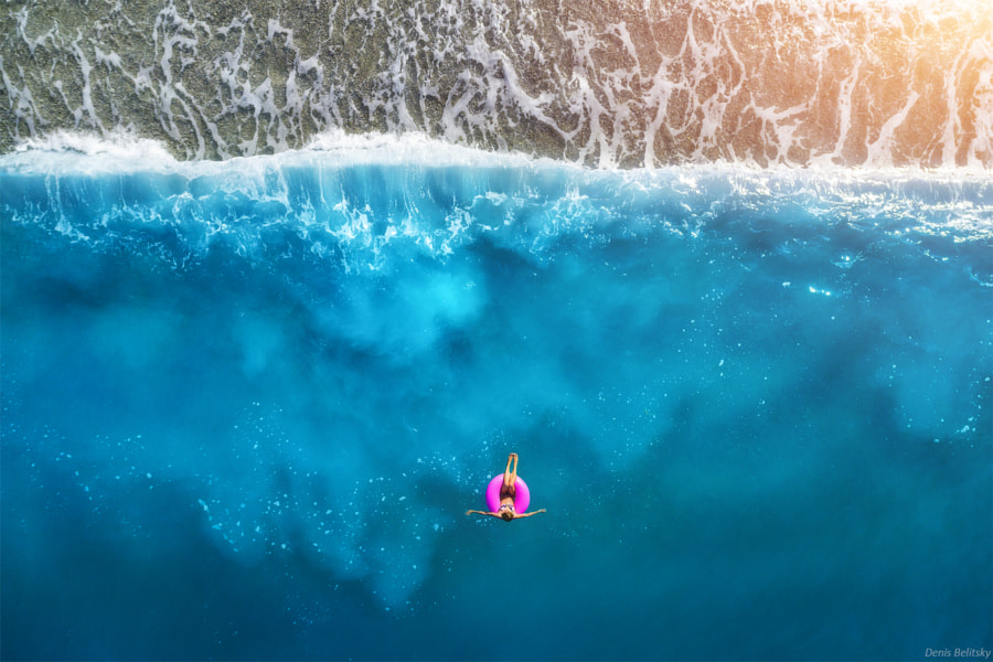 Aerial view of young woman swimming by Denys Bilytskyi on 500px.com