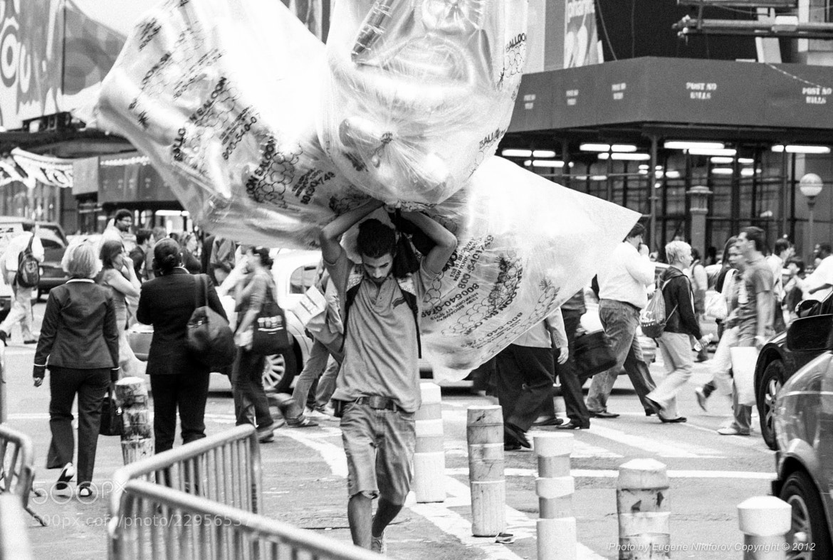 Photograph The Balloon Man, Times Square, Manhattan by Eugene Nikiforov on 500px