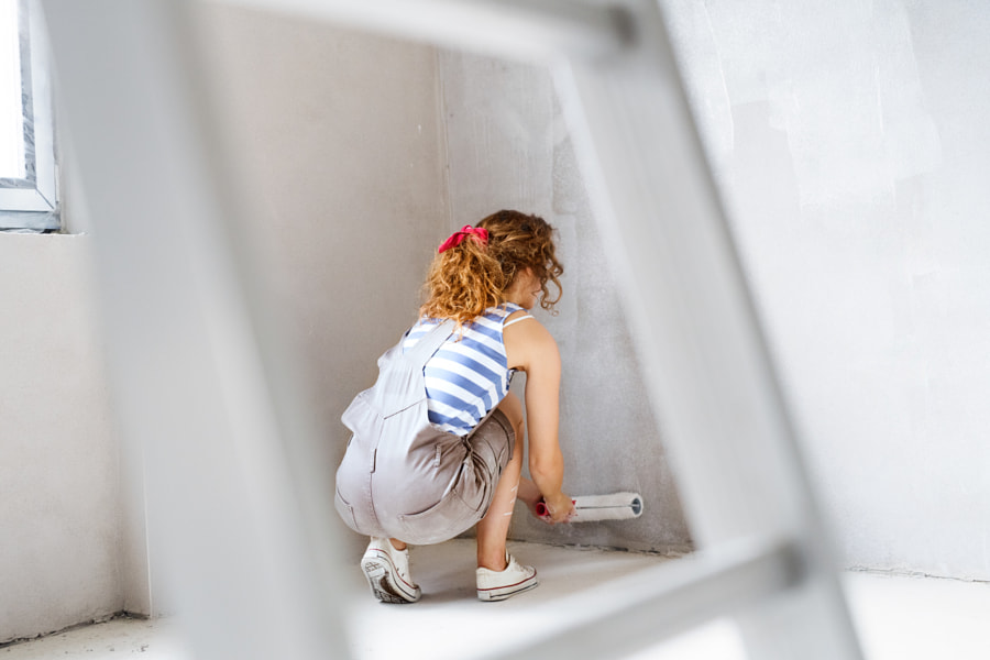 Young woman painting walls of her new house. by Jozef Polc on 500px.com