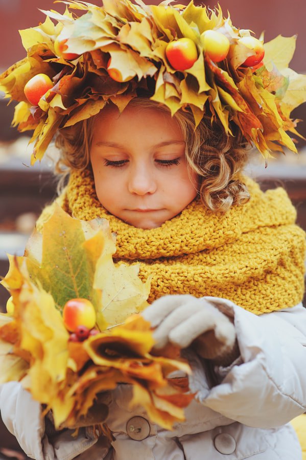 cute adorable toddler girl vertical portrait with bouquet of autumn leaves and wreath walking... by Maria Kovalevskaya on 500px.com