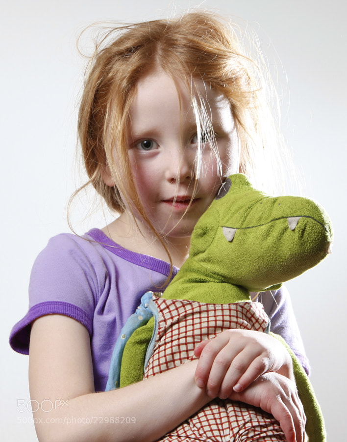 Little girl posing with her crocodile