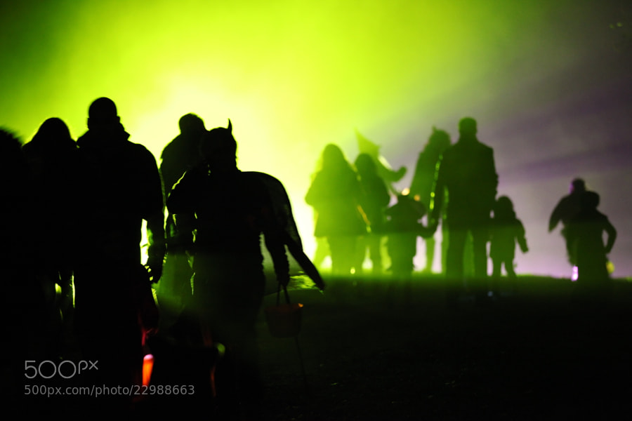 Was walking behind some people at Halloween in Norway, one place some have set up a green spotlight, I was waiting go get a nice shot, and then the devil came.