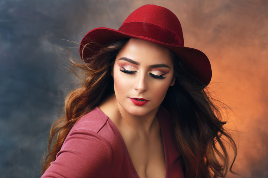 woman in red dress and red hat by Olena Zaskochenko on 500px