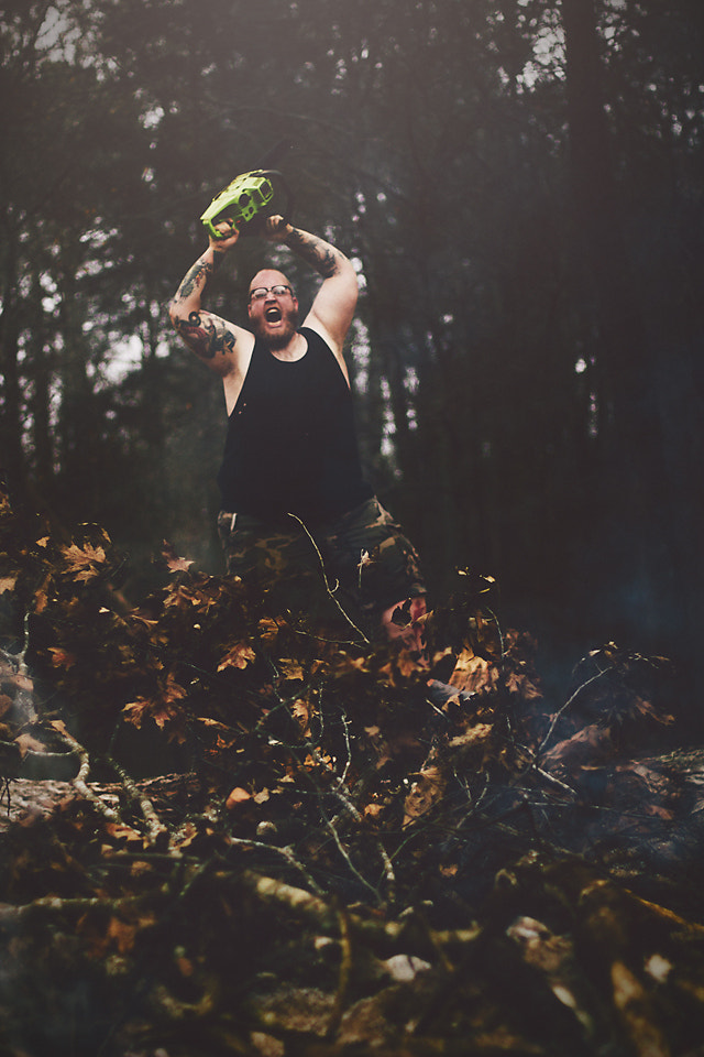 Photograph Adam + Chainsaw  by Michael Cooper on 500px
