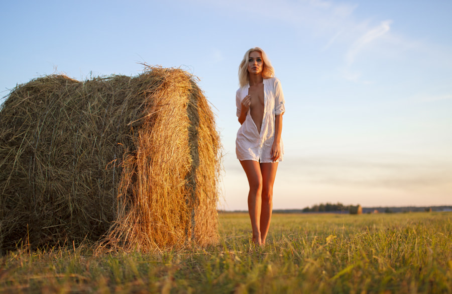 beautiful girl on the field with stacks by Evgen xvalko on 500px.com