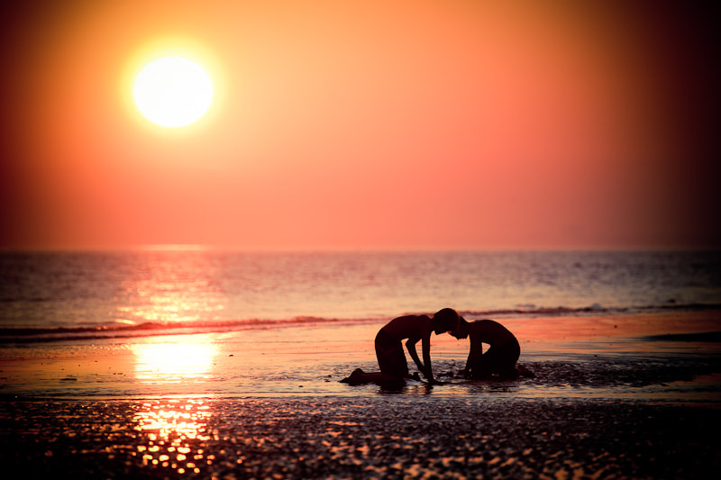 Photograph Children playing in sand at low tide by Katariina Jarvinen on 500px