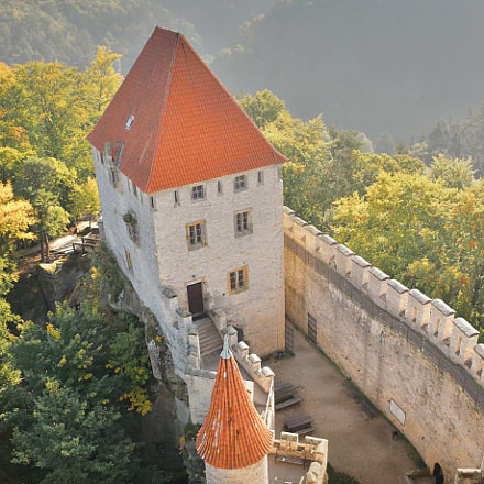Entrance area with courtyard of Kokorin castle seen from tower in Kokorinsko landscape area in...