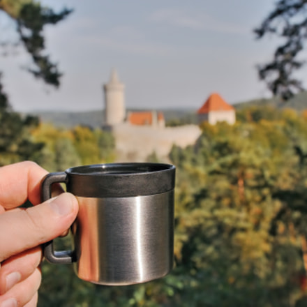 espresso cup from thermos with Kokorin castle on background in Kokorinsko landscape area in...