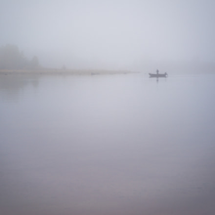 Fisherman in mist