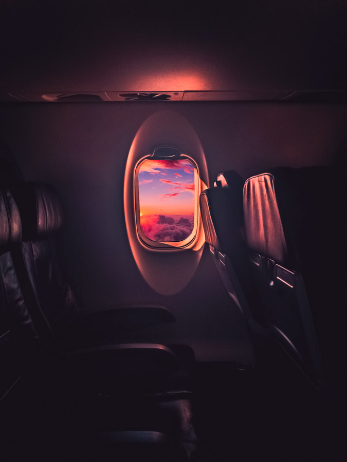 Watching the sunset from 32000ft by Chantz Martin