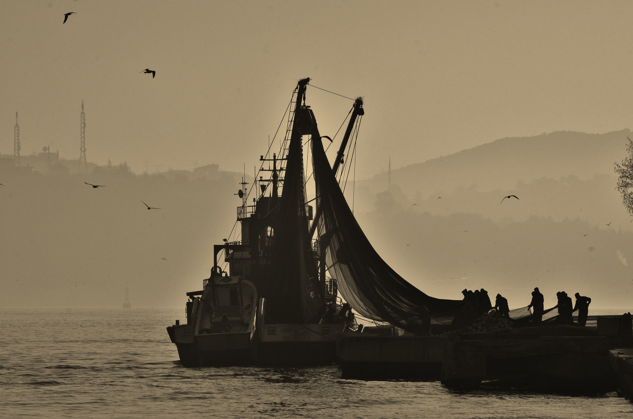 Photograph EMPTYING THE NET by ENGIN TAN on 500px