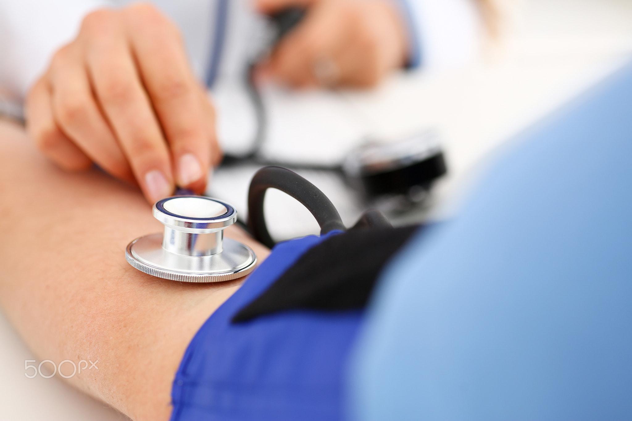 Female doctor arms make medic procedure closeup